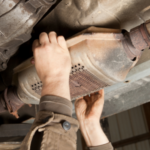 Image of person holding a catalytic converter